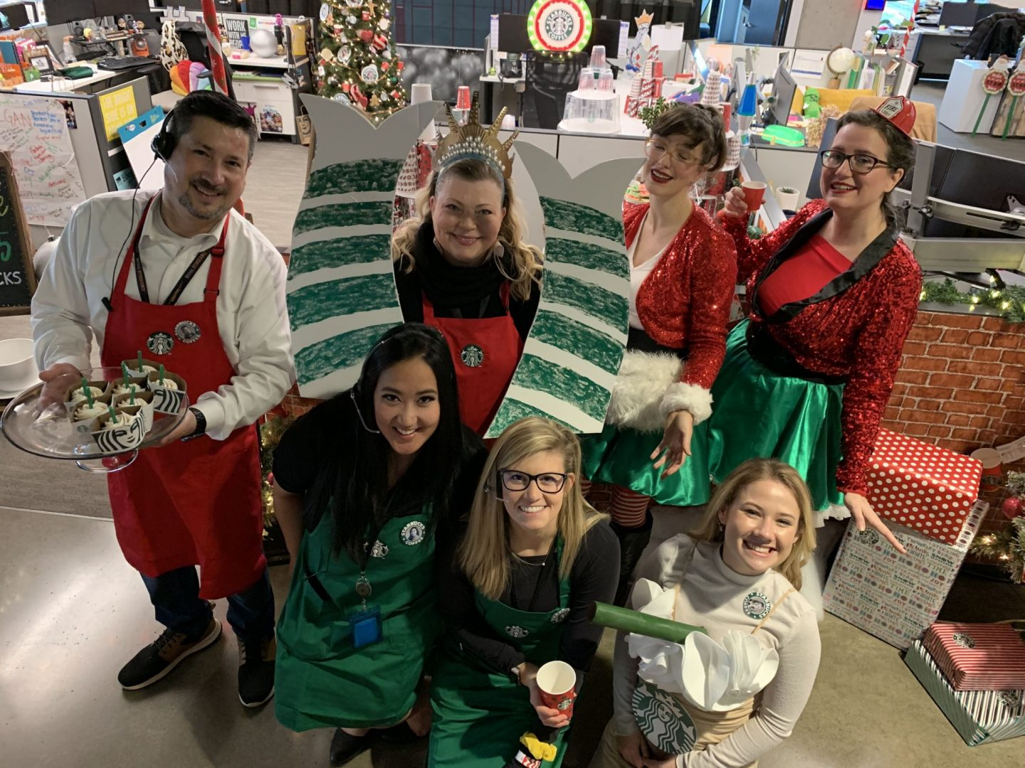 Deck the Halls with KING 5 Sales Department 4th Annual Holiday Pod Decorating Contest featuring a tree farm, Gingerbread Village, Santacon, Starbucks, and more!